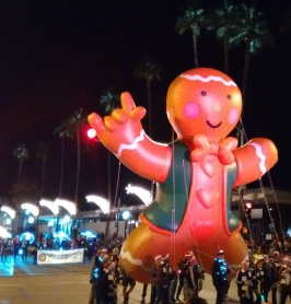A happy gingerbread boy gets to stay up late for the parade.