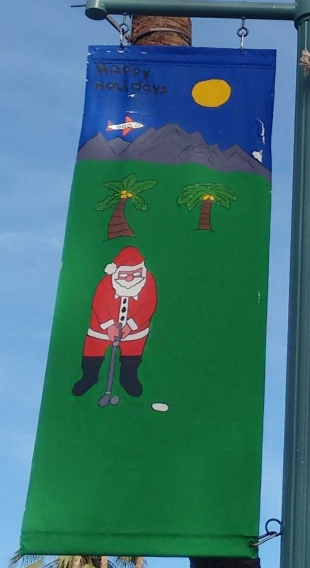 Fun holiday flags adorn Palm Canyon Drive.