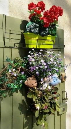 A playful flower arrangement adorns a village house in the historic center.