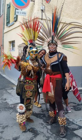 Aztec dancers pose during a break.