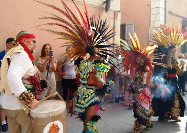 Aztec dancers take to the streets.